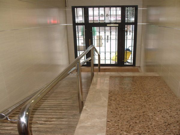 Rehabilitación integral interior vestíbulo carretera antigua de Valencia
